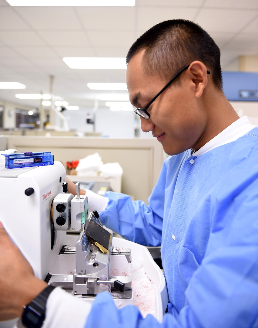 Senior Airman Biak Sang, a 959th Clinical Support Squadron histology technician, preps a block tissue sample for testing at the San Antonio Military Medical Center, Joint Base San Antonio-Fort Sam Houston, Jan. 13, 2017. The pathology lab is part of the 959th Medical Group, the third largest medical group in the Air Force Medical Service. The group is fully integrated with Army and civilian personnel at SAMMC, supporting operations at a 425-bed facility and the only Level 1 Trauma Center in the Department of Defense (U.S. Air Force photo/Staff Sgt. Jerilyn Quintanilla)