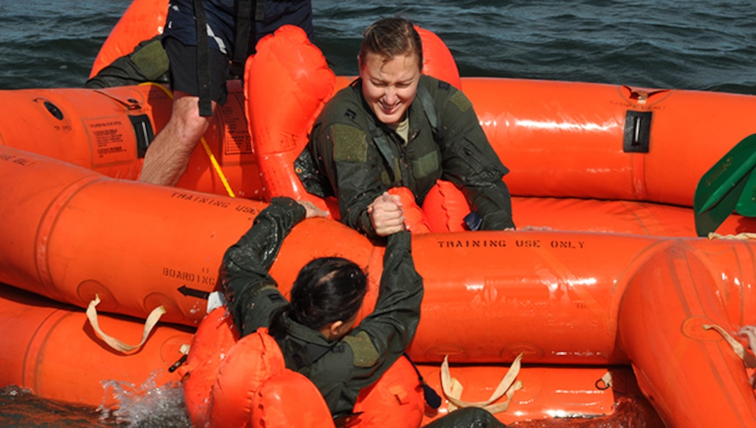 Members of the 94th Operations Group participate in Water Survival Training at Naval Air Station Key West, Florida February 23, 2017. During the two-day Survival, Evasion, Resistance and Escape course, members also completed Self Aid Buddy Care and combat survival. According to Col. Patrick Campbell, 94th Operations Group commander, this marks the first time this training has completed by aircrew, aeromedical and aircrew flight equipment personnel at the same time. (U.S. Air Force photo/Master Sgt. James Branch)