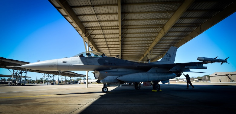 U.S. Air Force Airman 1st Class Victoria Suarez, 20th Aircraft Maintenance Squadron tactical aircraft maintainer, inspects an F-16CM Fighting Falcon on Shaw Air Force Base, S.C., Feb. 26, 2017. Tactical aircraft maintainers are responsible for the maintenance, upkeep, launch and recovery of the aircraft to ensure they are ready to takeoff at a moment's notice. (U.S. Air Force photo by Senior Airman Michael Cossaboom)