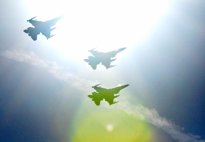 Three U.S. Air Force F-16CM Fighting Falcons assigned to the 77th Fighter Squadron fly over Arlington National Cemetery, Virginia, Feb. 24, 2017. The flyover was performed in memory of retired Air Force Col. Thomas Schaefer, who passed away May 31, 2016, and the five Airmen and three Marines who lost their lives attempting to save Schaefer and other hostages. (Courtesy Photo)