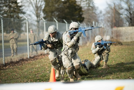 Soldiers from the 77th Sustainment Brigade practice casualty evacuation at the brigade level Best Warrior Competition Feb. 3, 2017.