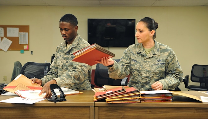 Tech. Sgt. Cassandra Eddins, 9th Force Support Squadron noncommissioned officer in charge of installation personnel readiness, and Senior Airman Kelvin Hailey, 9th FSS IPR journeyman, complete out-processing paperwork for deployers at Beale Air Force Base, California, Feb. 22, 2017. IPR reviews paperwork to ensure there are no discrepancies before individuals leave their home station. (U.S. Air Force photo/Airman Tristan D. Viglianco)