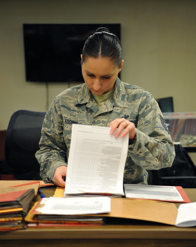 Tech. Sgt. Cassandra Eddins, 9th Force Support Squadron noncommissioned officer in charge of installation personnel readiness, reviews a completed pre-deployment checklist Feb. 22, 2017, at Beale Air Force Base, California. IPR works closely with unit deployment managers to ensure the checklists are filled out correctly by individuals deploying. (U.S. Air Force photo/Airman Tristan D. Viglianco)