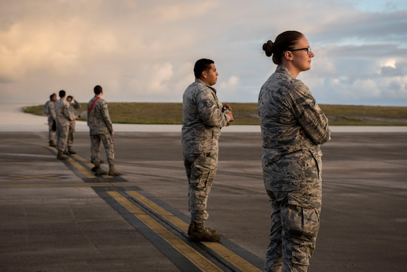 U.S. Air Force Airmen from the 67th Aircraft Maintenance Squadron form up before conducting a foreign object debris walk Feb, 23, 2017 on the flightline of Andersen Air Force Base, Guam. The 67th AMU flew from Kadena Air Base, Japan, to support one of the 22 flying units participating in annual exercise Cope North.  (U.S. Air Force photo by Senior Airman John Linzmeier)