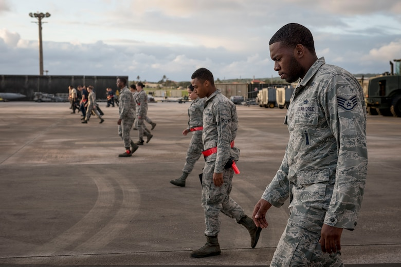 U.S. Air Force weapons Airmen from the 67th Aircraft Maintenance Squadron conduct a foreign object debris walk Feb, 23, 2017 on the flightline of Andersen Air Force Base, Guam. The 67th AMU is participating in annual exercise Cope North to increase interoperability between the U.S., Royal Australian Air Force and Japan Air Self-Defense Force. (U.S. Air Force photo by Senior Airman John Linzmeier)