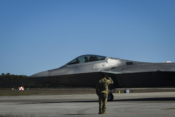 An F-22 Raptor assigned to the 95th Fighter Squadron, Tyndall Air Force Base, Fla., departs after receiving fuel from an MC-130J Commando II tanker aircraft assigned to the 9th Special Operations Squadron, Cannon AFB, N.M, during a forward area refueling point operation at Hurlburt Field, Fla., Feb. 26, 2017. FARP Airmen with the 1st Special Operations Logistic Readiness Squadron refueled three F-22s from an MC-130J during the operation. (U.S. Air Force photo by Airman 1st Class Joseph Pick)