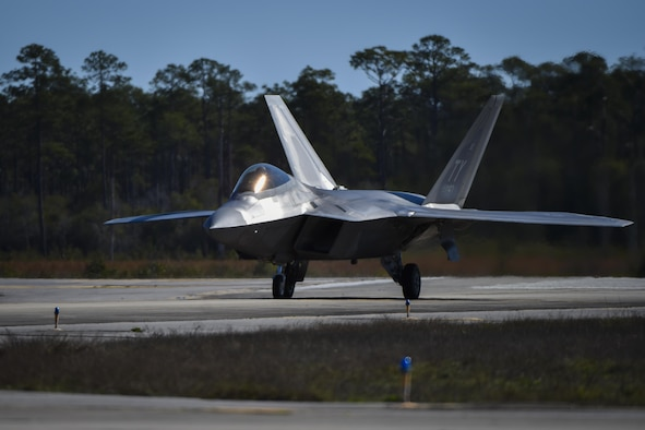 An F-22 Raptor assigned to the 95th Fighter Squadron, Tyndall Air Force Base, Fla., taxis at Hurlburt Field, Fla., Feb. 26, 2017. Forward area refueling point Air Commandos with the 1st Special Operations Logistic Readiness Squadron refueled three F-22s from an MC-130J Commando II tanker aircraft assigned to the 9th Special Operations Squadron, Cannon AFB, N.M., during the operation. (U.S. Air Force photo by Airman 1st Class Joseph Pick)
