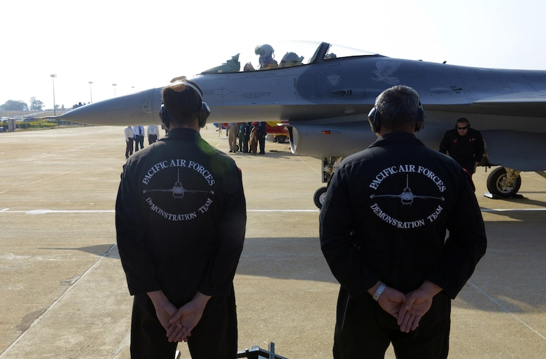 The U.S. Air Force's F-16 Fighting Falcon Pacific Air Forces Demonstration Team maintenance members stand at parade rest while Maj. Richard Smeeding prepares to taxi prior to an aerial performance during Aero India 2017 at Air Force Station Yelahanka Feb. 16, 2017. The F-16 is a compact, multi-role fighter aircraft. It is highly maneuverable and has proven itself in air-to-air combat and air-to-surface attack and provides a relatively low-cost, high-performance weapon system for the United States and allied nations. The United States participates in air shows and other regional events to demonstrate its commitment to the security of the Indo-Asia-Pacific region, promote the standardization and interoperability of equipment, and display capabilities critical to the success of current and future military operations. (U.S. Air Force photo by Capt. Mark Lazane)