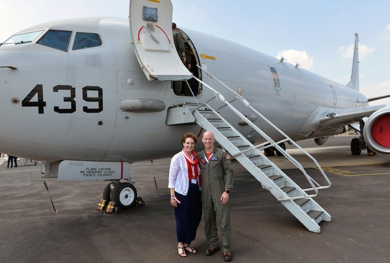 MaryKay Carlson, Charge d'Affaires of the U.S. Mission to India, stands outside a U.S. Navy P-8 Poseidon with U.S. Navy Commander Mike Albus, pilot and Executive Officer for Fixed Wing Patrol Squadron 10, Naval AIr Station Jacksonville, Fla., as part of Aero India 2017 at Air Force Station Yelahanka, India Feb. 16, 2017. The United States participates in air shows and other regional events to demonstrate its commitment to the security of the Indo-Asia-Pacific region, promote the standardization and interoperability of equipment, and display capabilities critical to the success of current and future military operations. (U.S. Air Force photo by Capt. Mark Lazane)