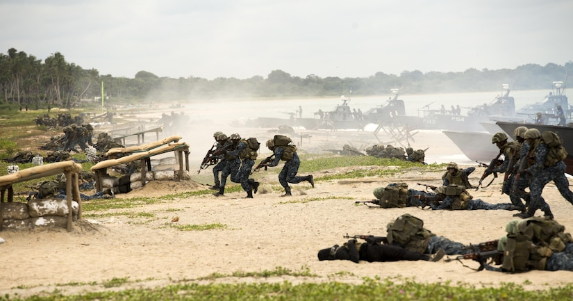 Sri Lankan Marines assault a beach as part of an amphibious capabilities demonstration during the Sri Lanka Marine Corps Boot Camp graduation at Sri Lankan Naval Station Barana in Mullikulum, Sri Lanka, Feb. 27, 2017. The SLMC will be an expeditionary force with specific missions of humanitarian assistance, disaster relief and peacekeeping support.