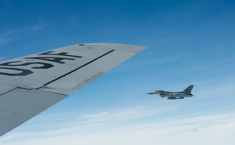 A U.S. Air Force F-16 assigned to the 14th Fighter Squadron from Misawa Air Base, Japan, flies next to a KC-135 Stratotanker after receiving an in-flight fuel during Cope North 2017, Feb. 16, 2017. The exercise includes 22 total flying units and more than 1,700 personnel from three countries and continues the growth of strong, interoperable relationships within the Indo-Asia-Pacific region through integration of airborne and land-based command and control assets. (U.S. Air Force photo by Senior Airman Keith James)