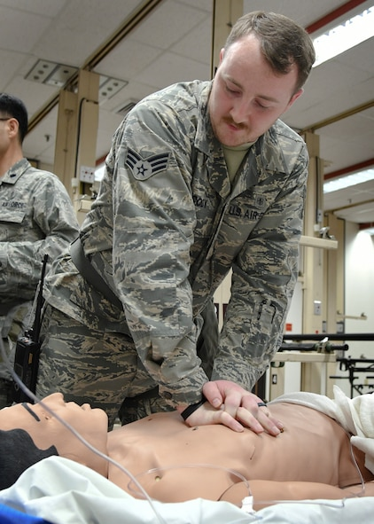 U.S. Air Force Senior Airman John Cody, 51st Medical Operations Squadron medical technician, performs cardiopulmonary resuscitation on a simulated patient as part of Exercise Beverly Herd 17-1 at Osan Air Base, Republic of Korea, Feb. 28, 2017. Medics from the 51st MDG use exercises like Beverly Herd to prepare themselves for real-world contingency operations. (U.S. Air Force photo by Airman 1st Class Gwendalyn Smith)