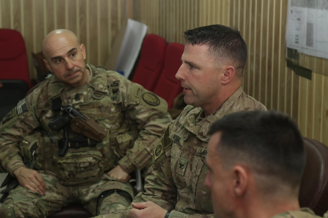 U.S. Army Col. Pat Work, (center), commander of the 2nd Brigade Combat Team, 82nd Airborne Division, discusses the brigade's advise and assist mission with Combined Joint Task Force-Operation Inherent Resolve leaders at tactical assembly area Hamam al-Alil, Iraq, Feb. 22, 2017. Paratroopers of the 2nd BCT, 82nd Abn. Div., moved a force into Hamam al-Alil to continue support to the Iraqi federal police during the offensive to liberate West Mosul. The Falcon Brigade enables their Iraqi security forces partners through the advise and assist mission, contributing planning, intelligence collection and analysis, force protection, and precision fires to achieve the military defeat of ISIS. CJTF-OIR is the global Coalition to defeat ISIS in Iraq and Syria. (U.S. Army photo by Staff Sgt. Jason Hull)