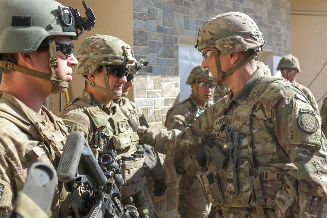 U.S. Army Lt. Gen. Stephen Townsend, commanding general, Combined Joint Task Force-Operation Inherent Resolve and XVIII Airborne Corps, thanks Spc. Jesse J. Goodwin, a combat engineer assigned to 37th Brigade Engineer Battalion, 2nd Brigade Combat Team, 82nd Airborne Division, for his hard work at tactical assembly area Hamam al-Alil, Iraq, Feb. 22, 2017. Paratroopers of the 2nd BCT, 82nd Abn. Div., deployed in support of CJTF-OIR, moved a force into Hamam al-Alil to continue support to the Iraqi federal police during the offensive to liberate West Mosul. The Falcon Brigade enables their Iraqi security forces partners through the advise and assist mission, contributing planning, intelligence collection and analysis, force protection, and precision fires to achieve the military defeat of ISIS. CJTF-OIR is the global Coalition to defeat ISIS in Iraq and Syria. (U.S. Army photo by Staff Sgt. Jason Hull)