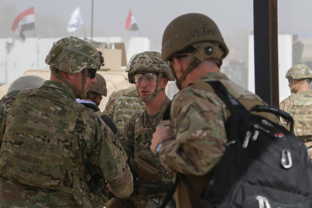 U.S. Army Command Sgt. Maj. Brian Knight, senior noncommissioned officer of 1st Squadron, 73rd Cavalry Regiment, 2nd Brigade Combat Team, 82nd Airborne Division, greets visitors at Hamam al-Alil, Iraq, Feb. 25, 2017. The 2nd BCT, 82nd Abn. Div., deployed in support of Combined Joint Task Force-Operation Inherent Resolve, enables their Iraqi security forces partners through the advise and assist mission, contributing planning, intelligence collection and analysis, force protection, and precision fires to achieve the military defeat of ISIS.  CJTF-OIR is the global Coalition to defeat ISIS in Iraq and Syria. (U.S. Army photo by Staff Sgt. Jason Hull)