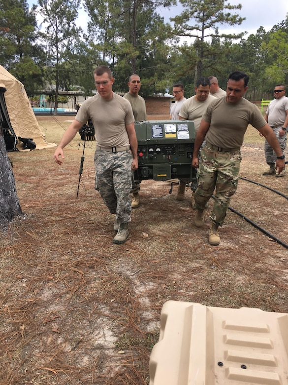 Personnel from Joint Task Force-Bravo's U.S. Southern Command Situational Assessment Team (SSAT) transport a generator during the set up of a deployment readiness exercise in Zambrano, Honduras, Feb. 21 through 23. The SSAT is a quick-reaction deployable team comprised of experts that provide the commander of USSOUTHCOM an immediate assessment of conditions and unique Department of Defense requirements which might be needed during a Humanitarian Assistance, Disaster Response event within the Central American Area of Responsibility.