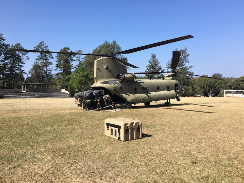 A CH-47 Chinook helicopter from JTF-Bravo's 1st Battalion, 228 Aviation Regiment unloads a pallet of equipment and supplies during a deployment readiness exercise of the U.S. Southern Command Situational Assessment Team (SSAT) in Zambrano, Honduras, Feb. 21 through 23. The SSAT is a quick-reaction deployable team comprised of experts that provide the commander of USSOUTHCOM an immediate assessment of conditions and unique Department of Defense requirements which might be needed during a Humanitarian Assistance, Disaster Response event within the Central American Area of Responsibility.