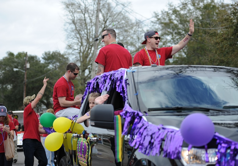 Members from the 335th Training Squadron participate in the Jeff Davis Elementary School Mardi Gras Parade, Feb. 24, 2017, Biloxi, Miss. The Keesler AFB Honor Guard and other base personnel also participated in the festivities. (U.S. Air Force photo by Kemberly Groue)