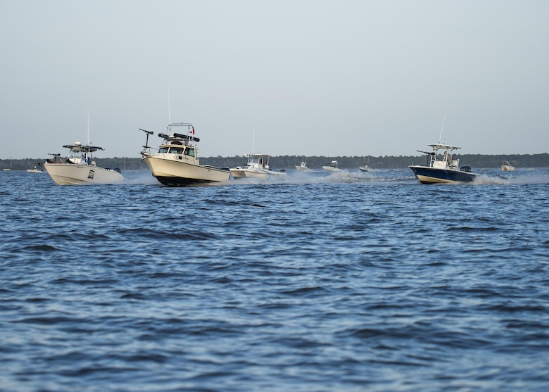Local boat captains and mariners operate fishing boats equipped with makeshift guns and weapons invaded the Choctawatchee Bay area Feb. 6 during the 86th Fighter Weapons Squadron exercise, Combat Hammer. The boat swarms helped create a realistic environment to provide exercise participants an opportunity to train like they fight. (U.S. Air Force/Ilka Cole)