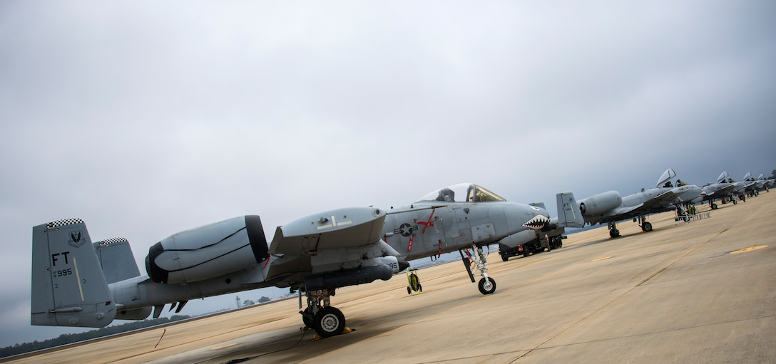 A-10 Thunderbolt IIs with the 74th Fighter Squadron from Moody Air Force Base, Ga., line the runway to receive fuel and maintenance Feb. 7 during Combat Hammer.   The 86th Fighter Weapons Squadron's Combat Hammer is a weapons system evaluation program at Eglin Air Force Base, Fla. (U.S. Air Force photo/Ilka Cole)