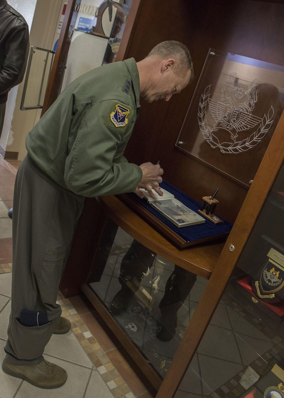 Lt. Gen. Mark Kelly, 12th Air Force (Air Forces Southern) Commander, signs the guest book at the 428th Fighter Squadron Feb. 23, 2017, at Mountain Home Air Force Base, Idaho. The book is reserved to log the visits of any notable figures who tour the squadron. (U.S. Air Force photo by Airman Jeremy D. Wolff/Released)