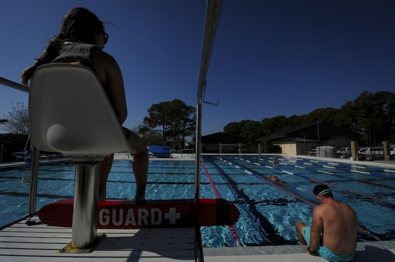 Bekka Boyd, left, a lifeguard at the Hurlburt Field Aquatic Center on Hurlburt, watches over Air Commandos swimming at the aquatic center on Hurlburt Field, Fla., Feb. 14, 2017. The aquatic center reopened Feb. 1, 2017, after renovations were made to the pool deck and bathrooms, and a handicap lift was installed. (U.S. Air Force photo by Airman 1st Class Dennis Spain)