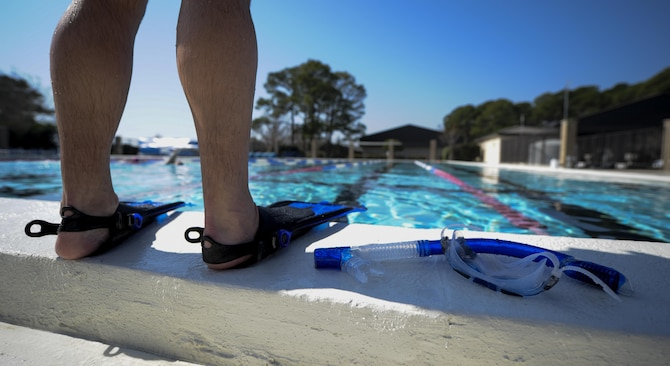A swimmer prepares to get in the pool at the aquatic center, Hurlburt Field, Fla., Feb. 14, 2017. Hurlburt Field's Aquatic Center pool deck and bathrooms were recently renovated and a handicap lift was added to provide a safer environment for all pool members. (U.S. Air Force photo by Airman 1st Class Dennis Spain)