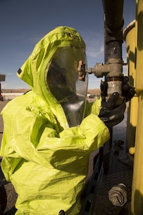 Scott Torres, firefighter and medic with Marine Corps Logistics Base Barstow's Security and Emergency Services repairs a leak on a training rig used during the hazardous materials training held aboard base, Feb. 15. The training provides realistic scenarios in which firefighters must respond with dexterity and precision.