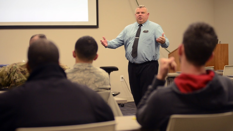 """Mike """"Rudy"""" Rudisill, Airman and Family Readiness Center community readiness consultant, leads a pre-separation briefing to service members preparing to leave the military.  The A&FRC pre-separation briefing is a prerequisite to the Transition Assistance Program's five-day Transition Goals, Plans, Success Workshop that informs those transitioning to civilian life of services and benefits available to assist them and their spouses during and after separating. (U.S. Air Force photo by Tammy L. Reed)"""