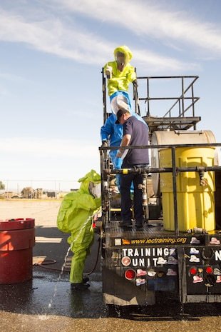 Simulated spills and leaks are repaired by firefighters during hazardous materials response training held aboard Marine Corps Logistics Base Barstow, Calif., Feb. 15.