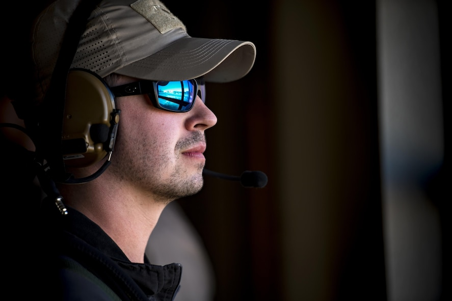 Senior Airman Shane Hardin, 563d Operations Support Squadron, scans through a window while acting as an oppositional force member, Feb. 22, 2017, at the Playas Training and Research Center, N.M. OPFOR is a role designed to simulate downrange threats and complicate training objectives with the ultimate goal of creating a realistic training environment for units preparing to deploy. Airmen from the 563d OSS fill this role in support of numerous joint exercises each year utilizing aircraft-threat emitters, vehicle-mounted simulation weapons and waves of ground troops. (U.S. Air Force photo by Staff Sgt. Ryan Callaghan)