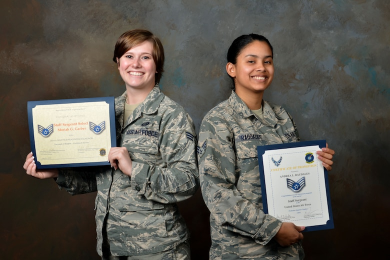 U.S. Air Force Senior Airman Andrea Raudales 609th Air Communications Squadron commander support staff (CSS) personnelist, and Senior Airman Moriah Garber, 20th Logistics Readiness Squadron CSS personnelist, smile while holding their staff sergeant-select certificates at Shaw Air Force Base, S.C., Feb. 22, 2017. Both Airmen, who have known each other since technical training, made senior airman below-the-zone as well as staff sergeant at the same time as one another. (U.S. Air Force photo by Airman 1st Class Destinee Sweeney)