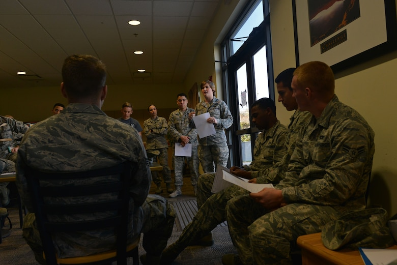 U.S. Air Force Senior Airman Moriah Garber, 20th Logistics Readiness Squadron commander support staff personnelist, speaks to Airmen during a Shaw Rising Four meeting about making senior airman below-the-zone at Shaw Air Force Base, S.C., Feb. 23, 2017. Garber and Senior Airman Andrea Raudales, 609th Air Communications Squadron commander support staff personnelist, previously treasurer and vice president of the Shaw Rising Four, are now the organization's Shaw 5/6 mentors. (U.S. Air Force photo by Airman 1st Class Destinee Sweeney)
