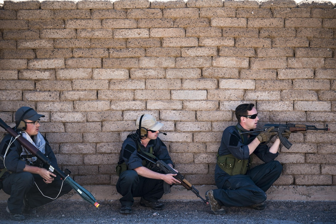 Staff Sgt. Nathan Franey, left, Senior Airman Shane Hardin, center, and Staff Sgt. Eric Fullmer, 563d Operations Support squadron, act as oppositional forces, Feb. 22, 2017, at the Playas Training and Research Center, N.M. OPFOR is a role designed to simulate downrange threats and complicate training objectives with the ultimate goal of creating a realistic training environment for units preparing to deploy. Airmen from the 563d OSS fill this role in support of numerous joint exercises each year utilizing aircraft-threat emittors, vehicle-mounted simulation weapons and waves of ground troops. (U.S. Air Force photo by Staff Sgt. Ryan Callaghan)
