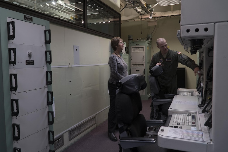 Laura Hyten, wife of Gen. John E. Hyten, U.S. Strategic Command commander, listens as Capt. Austin McKenzie, 90th Operations Group chief missile procedural trainer officer, discusses life as a missileer during a site visit to the 90th Operations Support Squadron's missile procedure trainer on F.E. Warren Air Force Base, Wyo., Feb. 22, 2017. The MPT allows missileers to run through a number of potential situations that can arise when on alert. Mrs. Hyten toured the base to meet with Airmen and families of the Mighty Ninety. (U.S. Air Force Photo by Lan Kim)