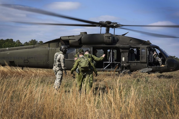U.S. Army personnel rescue Royal Canadian Air Force crew members from the 436 Transport Squadron as part of survival, evasion, resistance and escape training conducted during Green Flag Little Rock 17-04 Feb. 10, 2017, near Alexandria, La. During the exercise, aircrew members were selected randomly to participate in SERE training. (U.S. Air Force photo by Senior Airman Stephanie Serrano)