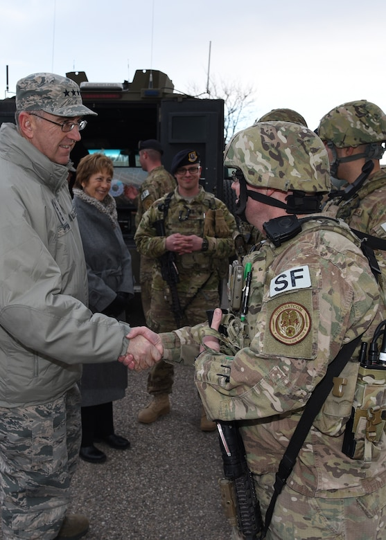U.S. Air Force Gen. John E. Hyten, U.S. Strategic Command commander, meets with Airmen from the 790th Missile Security Forces Squadron during a convoy demonstration at F.E. Warren Air Force Base, Wyo., Feb. 22, 2017. Convoys protect and secure cargo on route to designated launch facilities. This was Hyten's first visit to the 90th Missile Wing as USSTRATCOM commander. (U.S. Air Force photo by Glenn S. Robertson)