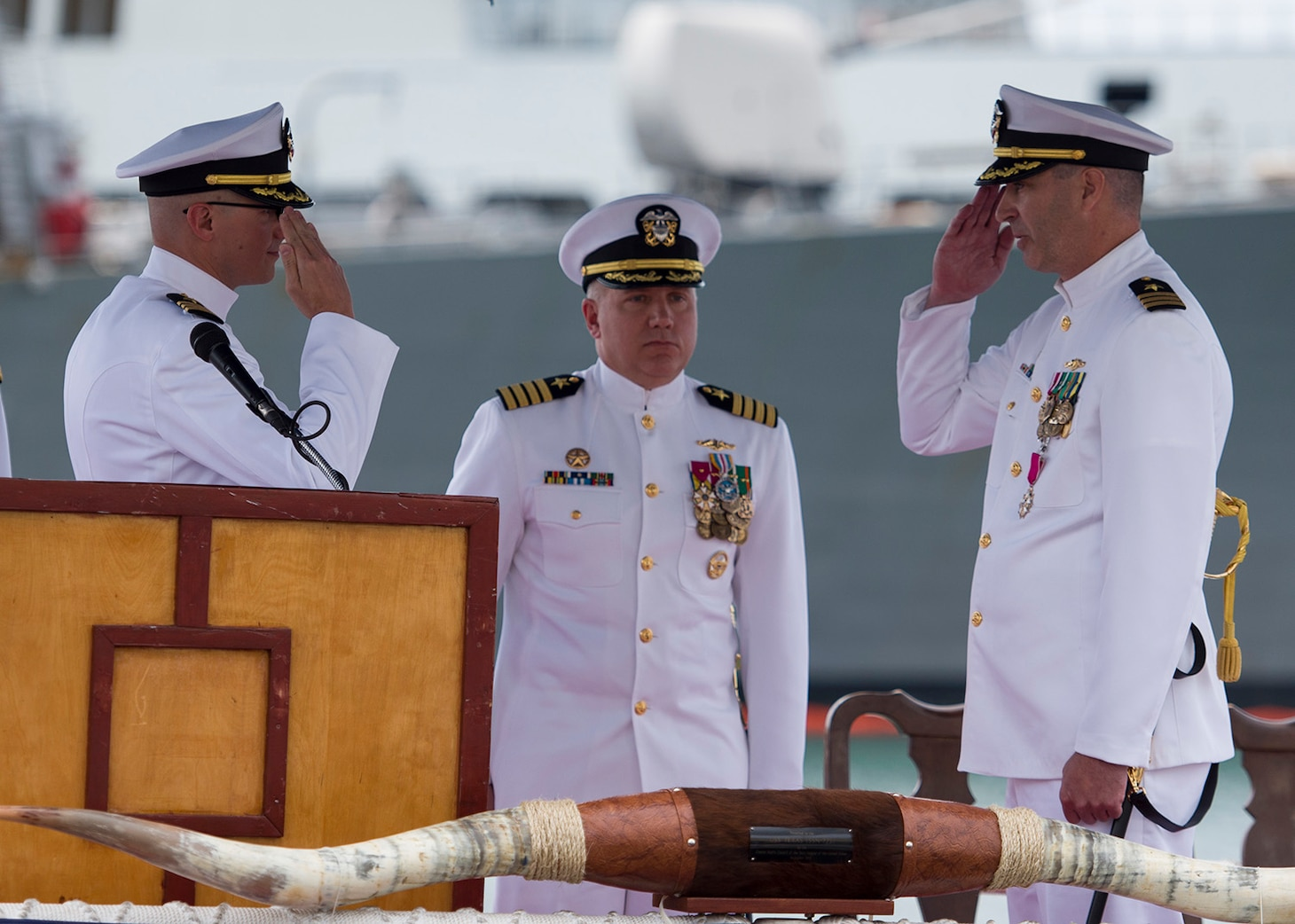 PEARL HARBOR, Hawaii (Feb. 24, 2017) Cmdr. Mike R. Dolbec, left, relieves Cmdr. Todd J. Nethercott, right, as the commanding officer of Virginia-class fast-attack submarine USS Texas (SSN 775), during a change of command ceremony on the historic submarine piers in Joint Base Pearl Harbor-Hickam. (U.S. Navy photo by Mass Communication Specialist 2nd Class Michael Lee/Released)