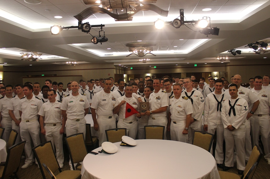 HONOLULU, Hawaii  (Jan. 27, 2017) -- Cmdr. Gabe Anseeuw, commanding officer of USS Greeneville (SSN 772) receives a Battle Efficiency award on behalf of the crew from Capt. Rick Seif, Commander of Squadron ONE Jan. 27, 2017 at the Hale Koa hotel in Honolulu.