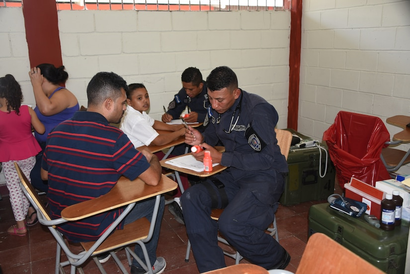 A police officer with the San Pedro Sula Metropolitan Police Unit Medical Brigade conducts a medical assessment during a medical civic action program mission in San Pedro Sula, Honduras, Feb. 18. Approximately 1,175 patients were seen in this one-day collaboration effort between local police, JTF-Bravo, local providers and private organizations. Working with Honduran police forces on joint exercises solidifies JTF-Bravo as a Partner-of-Choice for collaborative actions.