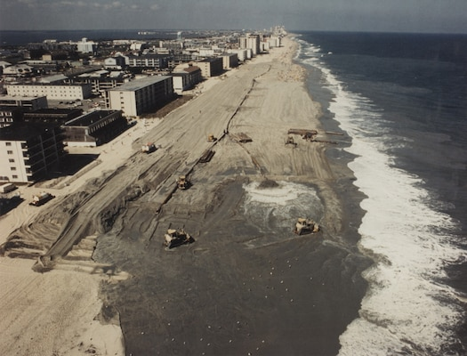Sand is pumped onto the beach at Ocean City in 1991 as part of initial construction of the beach berm and dune that are parts of the existing coastal storm risk management project. The Corps of Engineers, working closely with the state of Maryland and Ocean City, has continued to maintain the project over the years, and it has prevented an estimated nearly $1 billion in damages since initial construction.