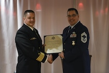 Chief Master Sgt. Bryan Bossert, security forces manager with the 911th Security Forces Squadron, received a certificate of his retirement during his retirement ceremony at the 911th Airlift Wing, February 11, 2017. The ceremony honored his 33 years in service as well as his accomplishments in the 911th SFS. (U.S. Air Force photo by Senior Airman Beth Kobily)