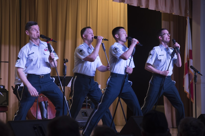 Members of the U.S. Air Force Band Singing Sergeants ensemble perform during a show at the Eisenhower Regional Recreational Center in The Villages, Fla., Feb. 22, 2017. The Singing Sergeants performed a variety of popular songs from the 1940s and '50s for audiences during their weeklong community outreach tour. (U.S. Air Force Photo by Airman 1st Class Rustie Kramer)
