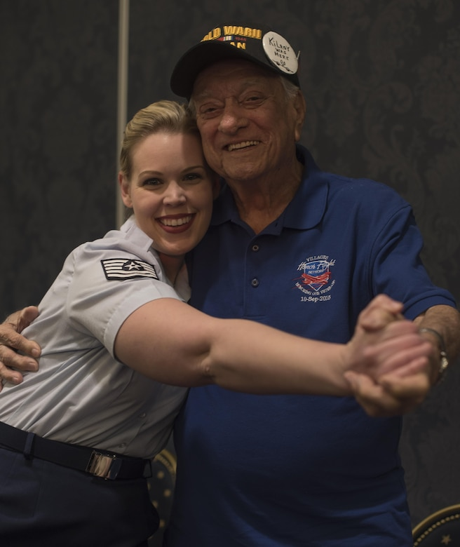 Tech. Sgt. Ashley Keeks, U.S. Air Force Band Singing Sergeants ensemble soprano vocalist, poses with Harry Maass, audience member, after a show at the Eisenhower Recreational Center in The Villages, Fla., Feb. 22, 2017. After performing a variety of musical hits from the 1940s and '50s, members of the Singing Sergeants met with local veterans and received a tour of the center. The facility has numerous displays of historical military memorabilia donated by veterans and their families. (U.S. Air Force photo by Airman 1st Class Rustie Kramer)