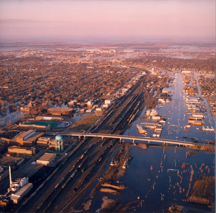 Aerial photo of the flooded downtowns of Grand Forks, North Dakota, and East Grand Forks, Minnesota, on April 20, 1997. --USACE St. Paul District File Photo