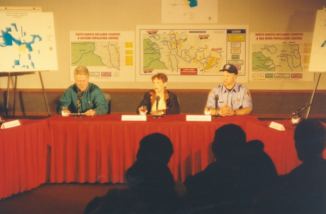 President Bill Clinton hosts a press conference in Grand Forks, North Dakota, April 21, 1997, after the city is inundated. --USACE St. Paul District file photo