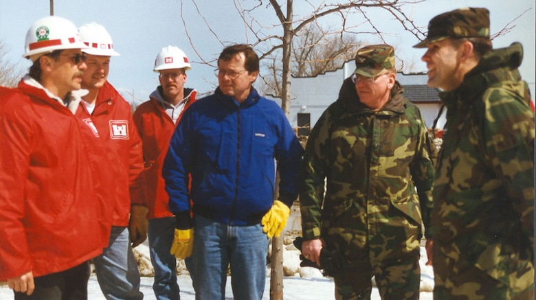 Matt Bray and Tim Grundhoffer, engineering; Pete Corkin, Rock Island District; U.S. Rep. Earl Pomeroy; Col. Mike Wonsik, St. Paul District commander; and Maj. Gen. Russell Fuhrman, Mississippi Valley Division, at Breckenridge, Minn., during the floods of 1997. --USACE St. Paul District File Photo