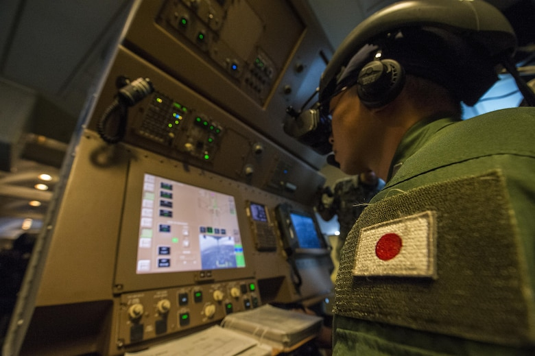 Japan Air Self-Defense Force Tech. Sgt. Yoshiaki Otabe, 404th Squadron boom operator, controls the boom while performing aerial refueling of an F-15 Eagle during Cope North 17, Feb. 28, 2017. The exercise includes 22 total flying units and more than 2,700 personnel from three countries and continues the growth of strong, interoperable relationships within the Indo-Asia-Pacific region through integration of airborne and land-based command and control assets. (U.S. Air Force Photo by Senior Airman Keith James)