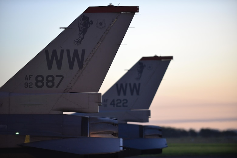 Wild Weasel F-16 Fighting Falcons sit side-by-side at Royal New Zealand Air Force Base Ohakea, New Zealand, Feb. 24, 2017. Maj. Richard Smeeding, F-16 demo pilot with the Pacific Air Forces demonstration team, and Capt. Mike Dreher, F-16 demo safety observer with the Pacific Air Forces' demonstration team, were the first to arrive, ahead of more than 20 more crew members traveling with them. (U.S. Air Force photo by Senior Airman Jarrod Vickers)