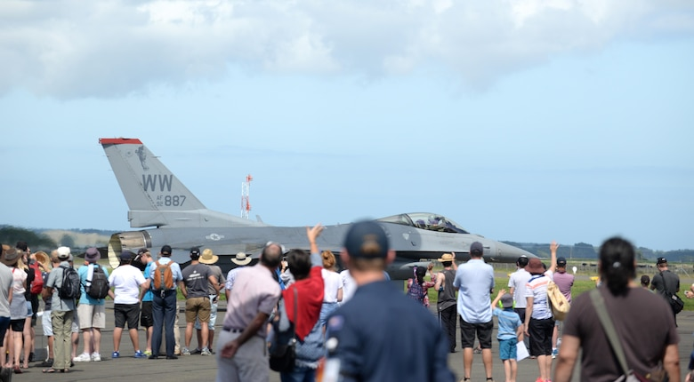 Onlookers welcome Maj. Richard Smeeding after his aerial demonstration at Royal New Zealand Air Force Base Ohakea, New Zealand, Feb. 26, 2017. The Air Tattoo is held once every five years. The 2017 show celebrates 80 years of the RNZAF. Partner nations practice interoperability by bringing together 13 international aircraft from eight different countries. (U.S. Air Force photo by Senior Airman Jarrod Vickers)